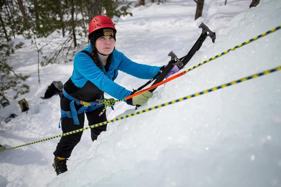Samantha Troiano climbed an ice wall in a mountaineering skills event held last weekend at Camp Sayre in Milton.