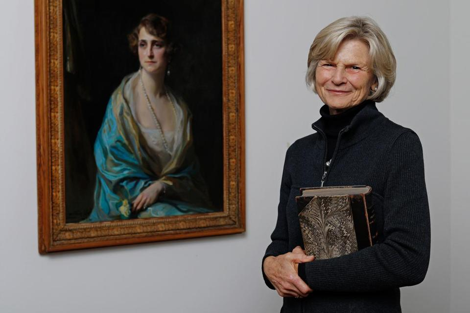 Bettina Burr with a 1925 portrait of her grandmother Clarice de Rothschild by the artist de Laszlo, which will be shown at the MFA.