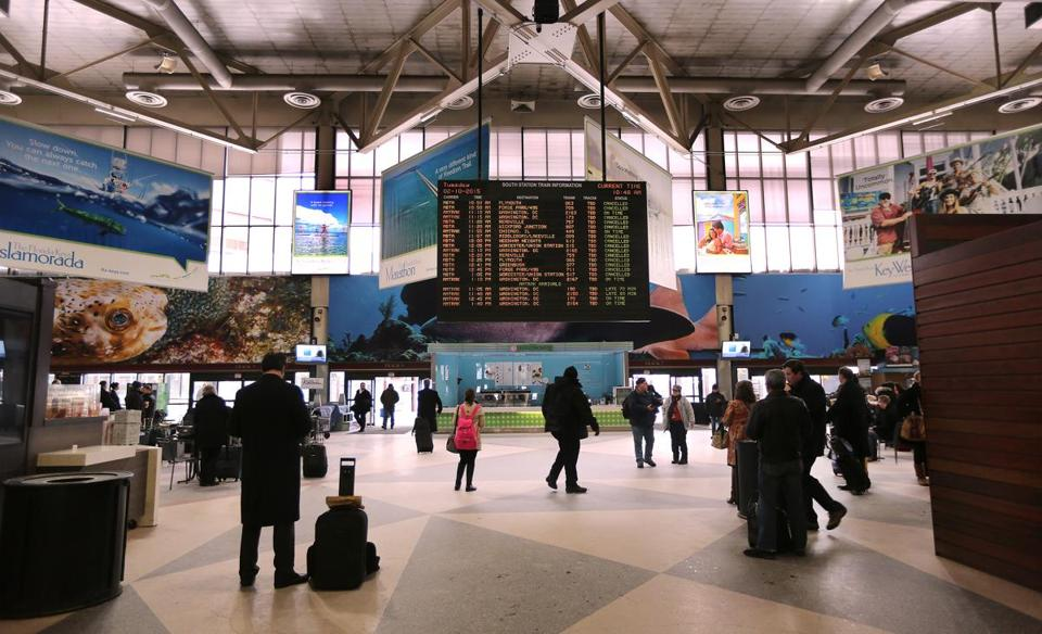 Commuters at South Station (above) and North Station are hearing a new computerized voice announcing train departures and arrivals.