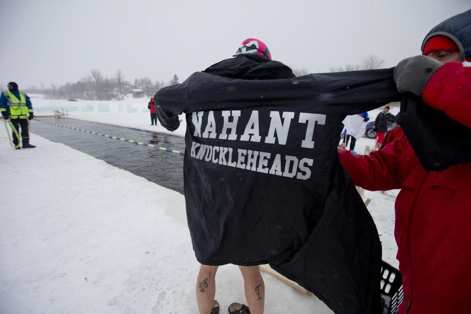 A member of the Nahant Knuckleheads gets ready to take the plunge into 30.5 degree waters.