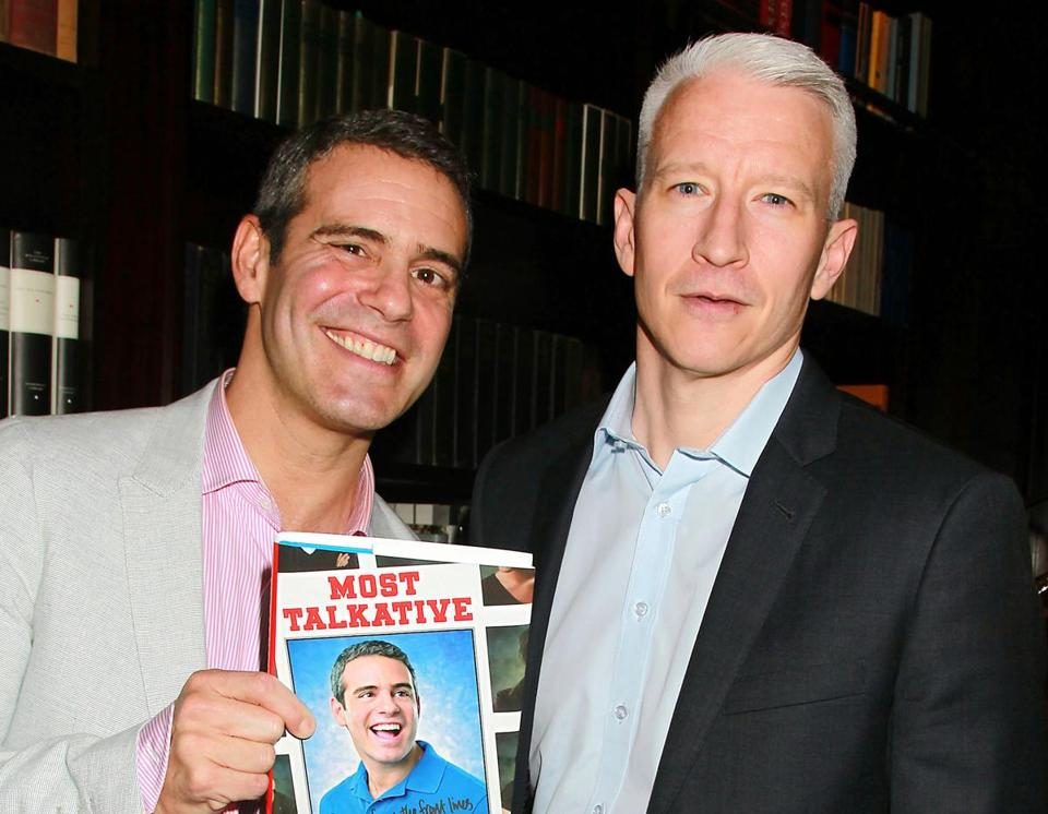 "Bravo TV personality Andy Cohen (left) and CNN's Anderson Cooper at a party celebrating Cohen's book ""Most Talkative: Stories from the Front Lines of Pop Culture"" in 2012."