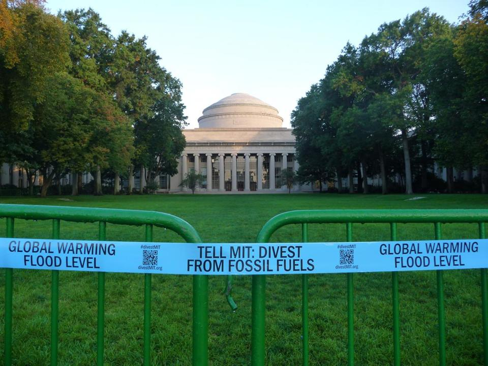 Students calling on MIT to divest from fossil fuels wrapped the entire campus in four miles of blue custom-made caution tape last spring, marking the flood levels – exacerbated by global warming – that a Hurricane Sandy-strength storm could bring to the campus in 2050.