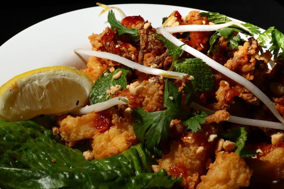 Crispy Thai-style calamari is served fresh and seasoned with a sweet and spicy sauce.