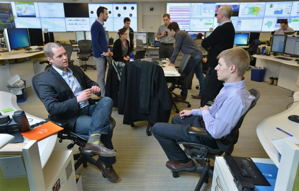 Nate Brown (left), EnerNOC's lead generation manager, talked with lead generation specialist Ryan Hagan in the company's Network Operations Center.