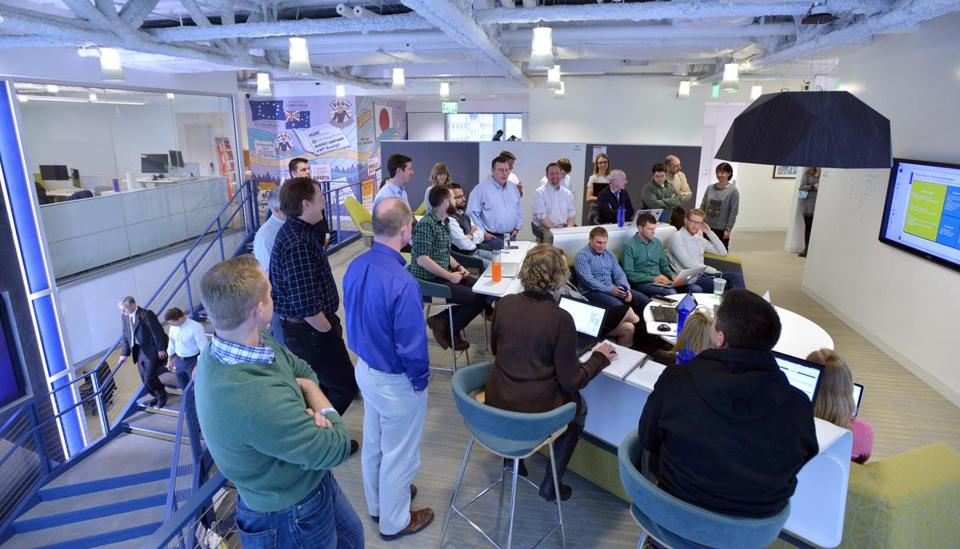 "Employees attended a meeting held in the ""media scape"" area of EnerNoc's headquarters."