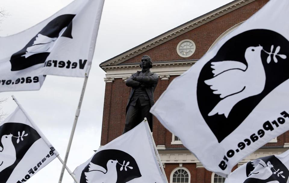 Boston, Massachusetts -- 11/09/2014-- Flags for Veterans for Peace surround a statue of Samuel Adams as the the Veterans for Peace Parade marches past in Boston, Massachusetts November 11, 2014. Jessica Rinaldi/Globe Staff Topic: 12veterans Reporter: