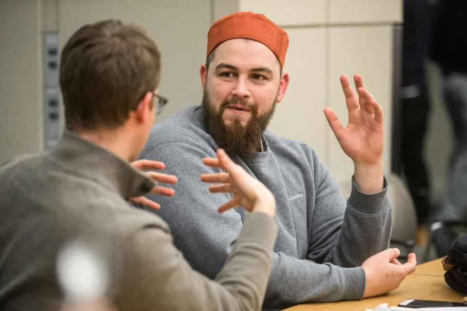 "AbdelRahman Murphy (right) spoke with Ryan Strom  (left) and other attendees during a ""Coffee Talk"" held in the Bush Room at MIT."