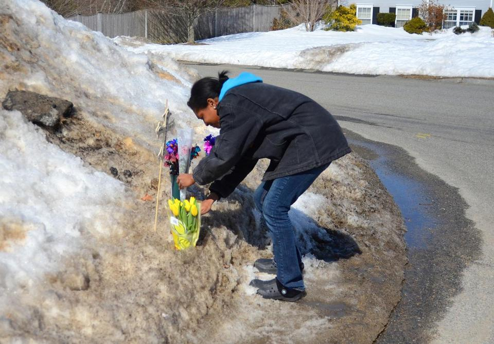 Neighbor Iyannah Tillman added to a memorial to Marjorie Cochrane at the Plymouth accident scene.
