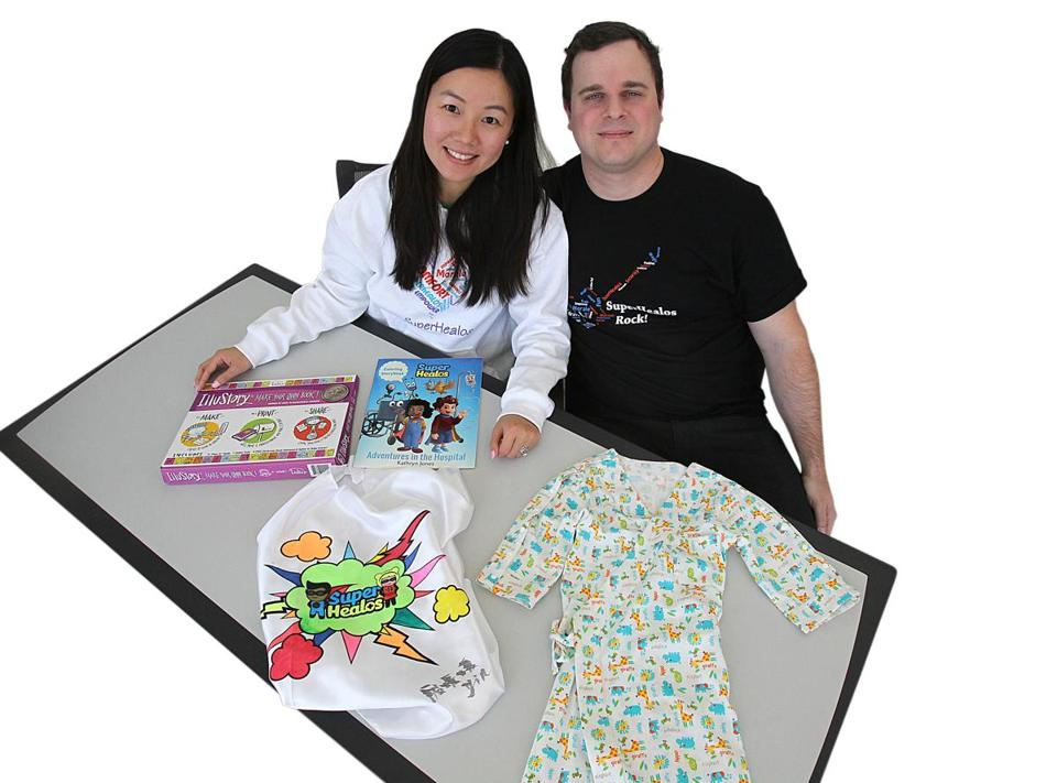 Newton couple Yuanyuan Yin and Dylan Murphy with some of the products offered by their startup company, SuperHealos.