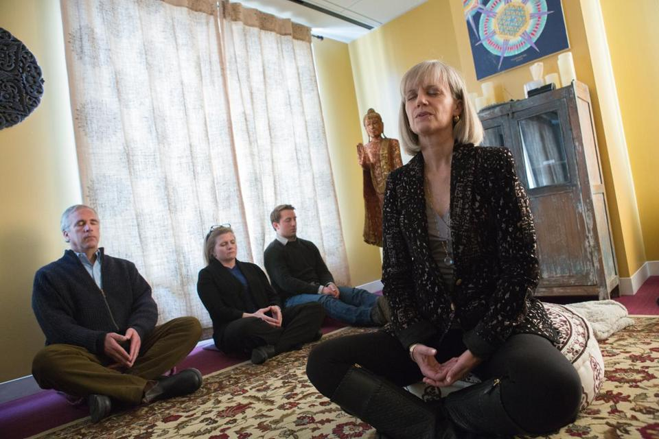 office meditation. Kip Hollister, Chief Executive Of Hollister Staffing, Leads Employees In Guided Meditation A Office