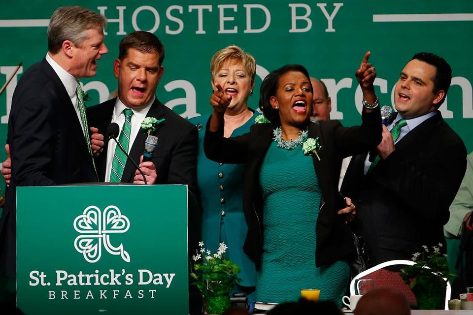 Governor Charlie Baker and Mayor Marty Walsh joined state Senator Linda Dorcena Forry (center) during a song at the St. Patrick's Day breakfast Sunday in South Boston.