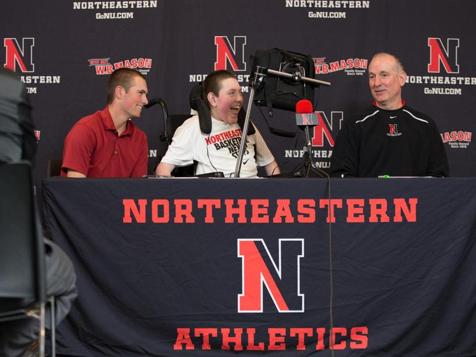 Max Plansky (center) with brother Mike (left) when coach Bill Coen announced Max's letter of intent in 2013.