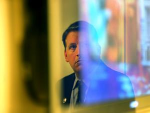 Gardner Museum security director Anthony Amore was reflected in a TV screen as he showed evidence in the ongoing investigation.