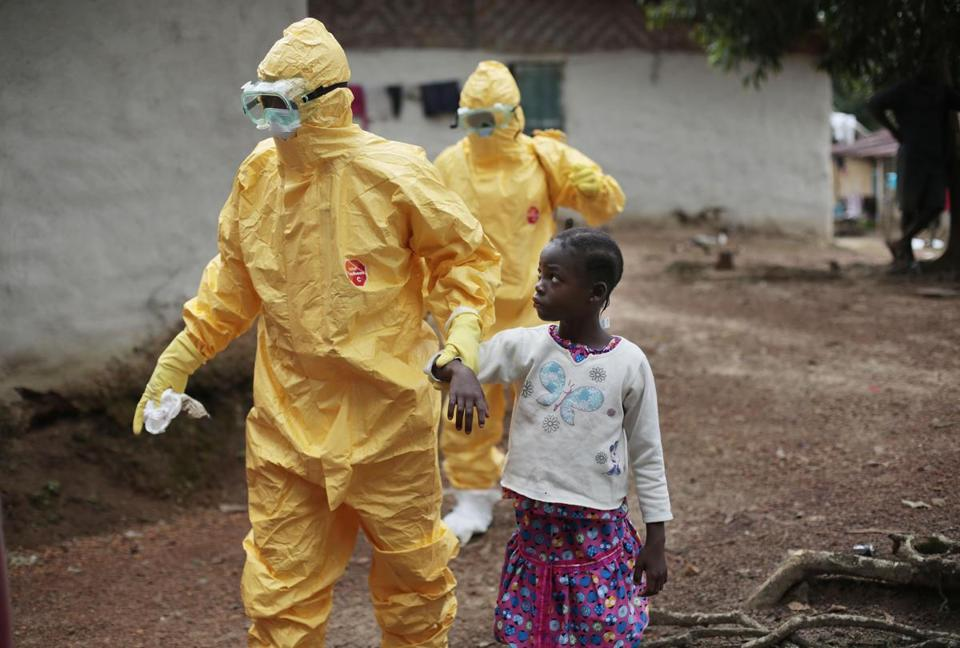 A 9-year-old was escorted to an ambulance after showing signs of Ebola in a Liberian village.