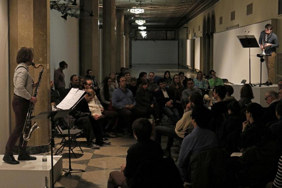 "Bass clarinetists Samuel Dunscombe (far left) and Curt Miller perform Pierluigi Billone's ""1+1=1"" on Friday at 808 Gallery."