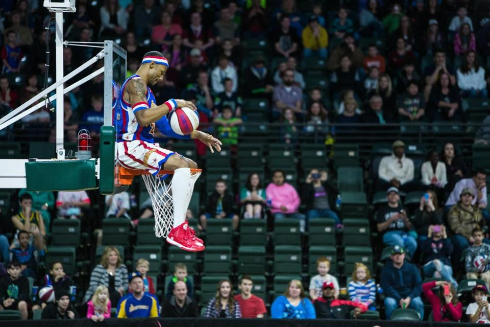 Harlem Globetrotters score during a game against the Washington Generals, Monday, Feb. 16, 2015, at the XFINITY Arena in Everett, Washington. Families from around the region flocked to Everett to enjoy incredible ball handling wizardry, trick shots and plenty of hardwood comedy. (AP Photo/seattlepi.com, Jordan Stead)