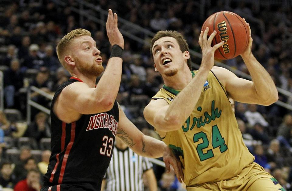 PITTSBURGH, PA - MARCH 19: Pat Connaughton #24 of the Notre Dame Fighting Irish goes up against Zach Stahl #33 of the Northeastern Huskies in the second half during the second round of the 2015 NCAA Men's Basketball Tournament at Consol Energy Center on March 19, 2015 in Pittsburgh, Pennsylvania. (Photo by Justin K. Aller/Getty Images)