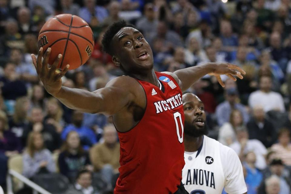 North Carolina State's Abdul-Malik Abu (0) grabs a pass against Villanova during the first half of an NCAA tournament third round college basketball game, Saturday, March 21, 2015, in Pittsburgh. (AP Photo/Gene J. Puskar)