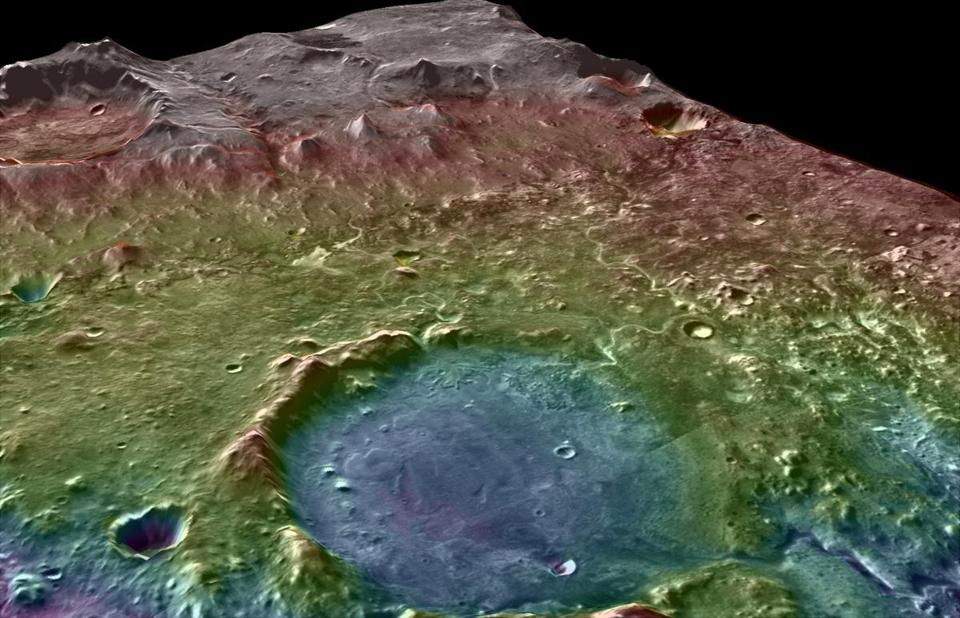 A colored topographic map (blue marks low elevations) shows the area around Jezero Crater. Flowing water would have gathered any biologic or organic material from a wide area and deposited it at the crater, making it a logical landing site for a future Mars rover mission.