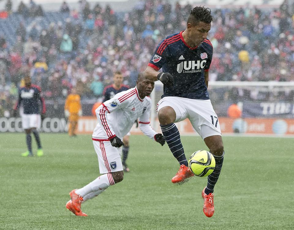 Foxborough MA 3/27/15 New England Revolution Juan Agudelo traps the ball in front of San Jose Earthquakes Sanna Nyassi during first half action at Gillette Stadium on Saturday March 28, 2015. (Matthew J. Lee/Globe staff) Topic: Reporter: