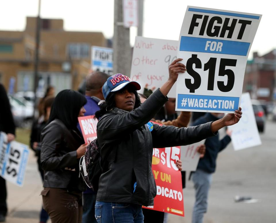 Boston 04/02/2015 Latoya Berry (cq) (cq) was part of a group protesting for higher wages. They were protesting near a McDonald's Restaurant on Massachusetts Avenue. Staff/Photographer Jonathan Wiggs Topic: Reporter