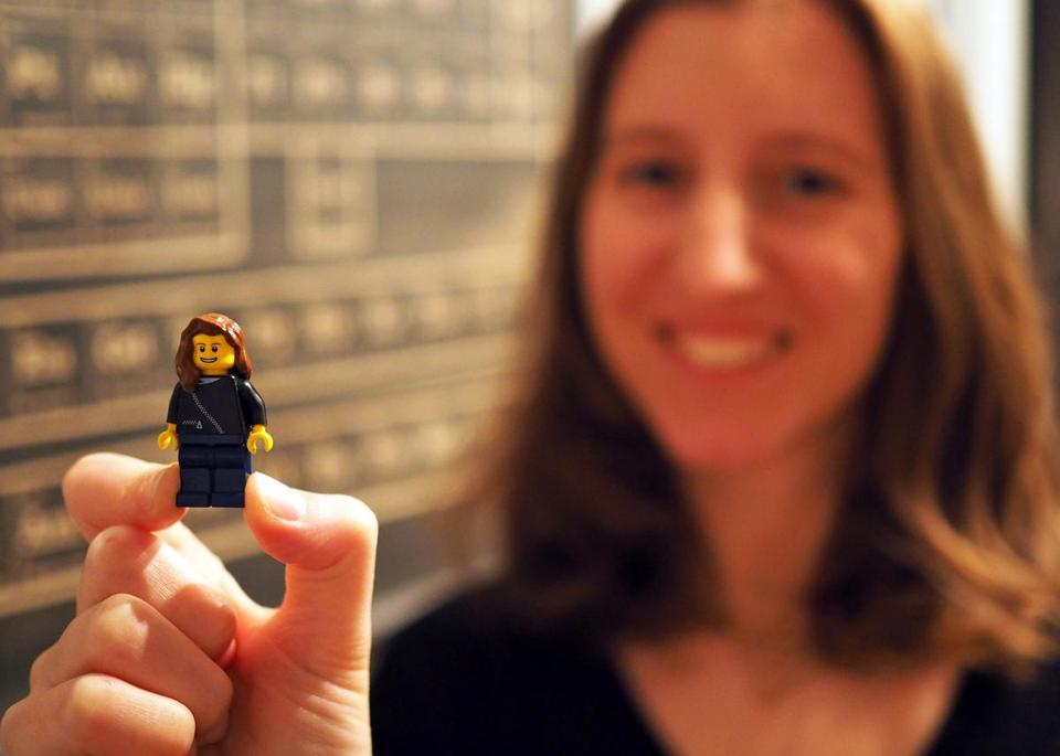 Maia Weinstock holds a Lego version of herself.