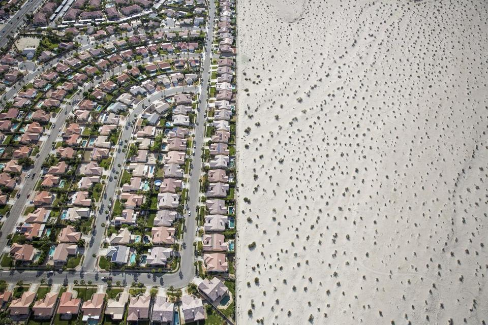 A housing complex abuts the desert in Cathedral City, Calif. Some fear the state's glamorous image is hurt by a drought.