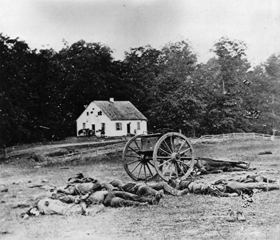 Bodies await burial in front of Dunker Church at Antietam, Maryland, in 1862 during the American Civil War.