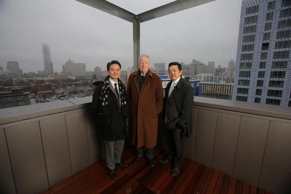 "Boston, MA - 04/09/15 - Shaping the Boston skyline are (left to right) Kairos Shen, Director of Planning at the Boston Redevelopment Authority, Henry ""Harry"" Cobb, the architect of the Hancock Tower and Moakley Courthouse, and developer Kelly Saito, a partner at Gerding Edlen. They are pictured on the rooftop penthouse of Troy Boston, a new residential building developed by Saito's company. At right is another building of that same development still under construction. Lane Turner/Globe Staff Section: MAG Reporter: sure Slug: 10gamechangers-realestate"