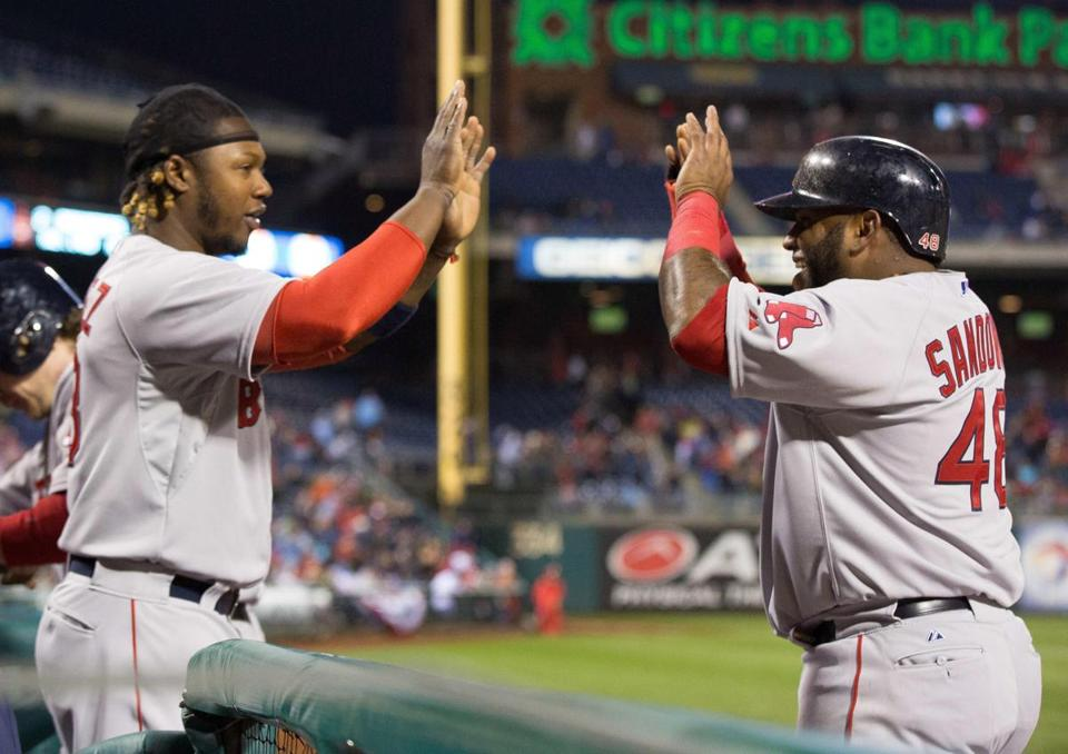 Apr 9, 2015; Philadelphia, PA, USA; Boston Red Sox third baseman Pablo Sandoval (48) high fives left fielder Hanley Ramirez (13) after scoring against the Philadelphia Phillies during the third inning at Citizens Bank Park. Mandatory Credit: Bill Streicher-USA TODAY Sports