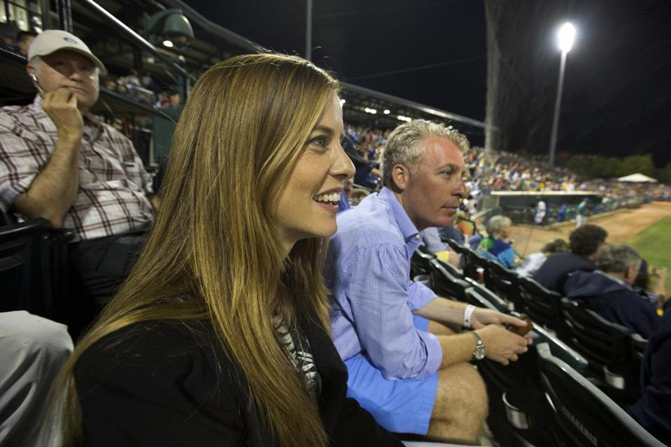 Charleston, S.C.-April 9, 2015-Globe Staff Photo by Stan Grossfeld-- Tyler Tumminia, who runs four minor league teams and owns one collegiate team sits in the stands of the Charleston RiverDog opener with Peter Freund, a Yankee minority owner and co-owner of the team.