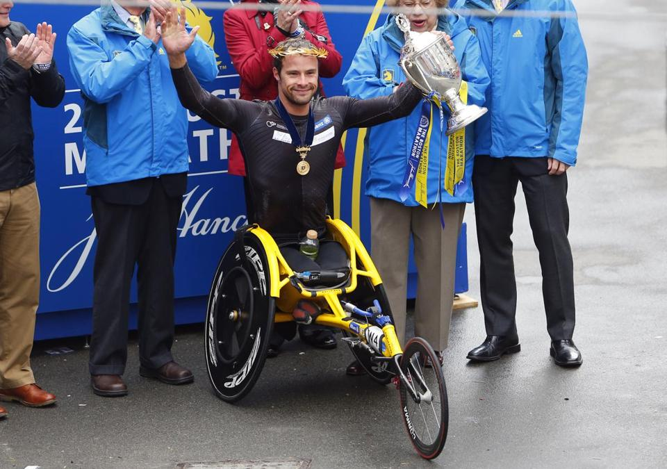 Marcel Hug celebrates his victory in the men's wheelchair division.