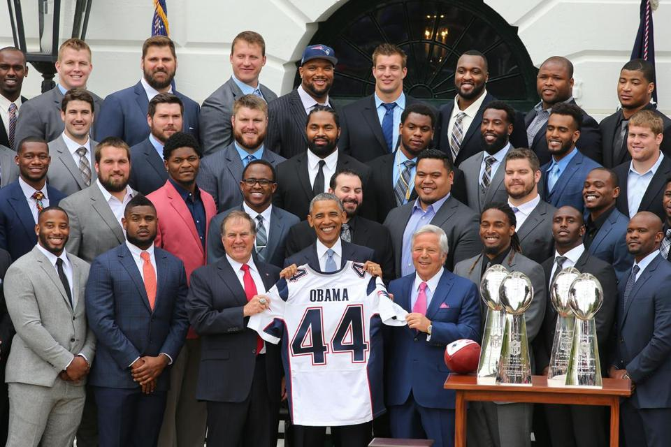 President Obama held up a Patriots jersey presented to him by the team.