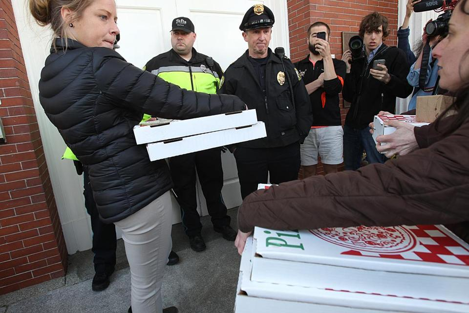 Tufts University police prevented pizza from being delivered to protesters sitting in at Ballou Hall on Friday afternoon.