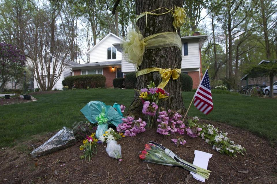 Flowers and ribbons adorned the tree at the Rockville, Md., home of Warren Weinstein, who was kidnapped in Pakistan in 2011 and killed by a US drone strike in January.
