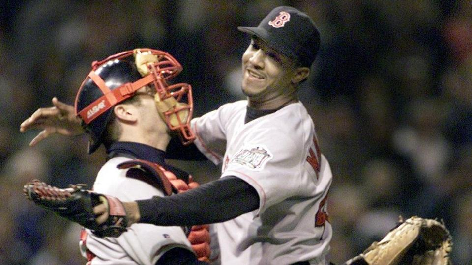 Cleveland, OH - 10/11/99 - Pedro Martinez gets hosited by catcher Jason Varitek after recording the final out of the improbable Game 5 victory over the Cleveland Indians that sent the Red Sox to the ALCS vs. the New York Yankees. (FOR POSSIBLE SPECIAL SECTION PREVIEW USE.)