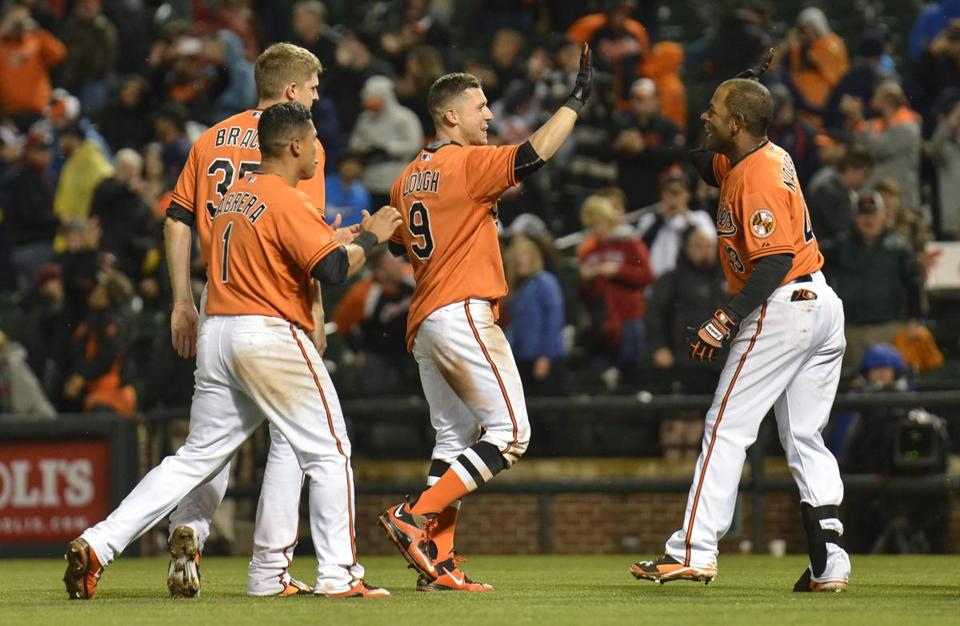 Orioles left fielder David Lough (9) celebrated after hitting the game-winning home run in the 10th inning.
