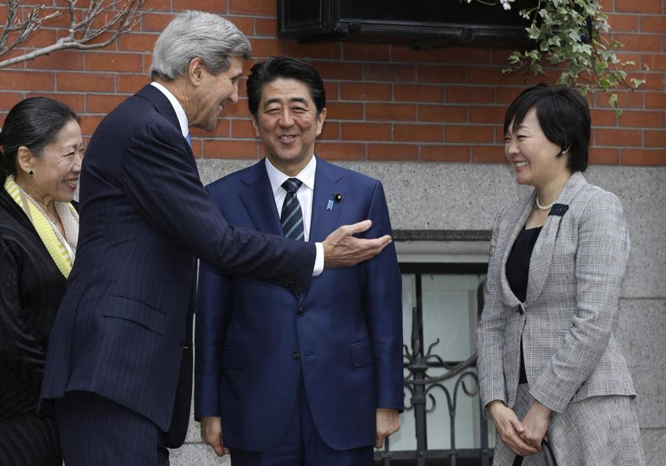 Secretary of State John Kerry greeted Japanese Prime Minister Shinzo Abe (center) and his wife Akie Abe (right) in front of Kerry's Beacon Hill home on Sunday.