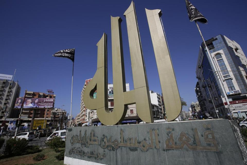 "The centerpiece of Nour Square in Tripoli is a statue of the word ""God"" written in Arabic calligraphy."