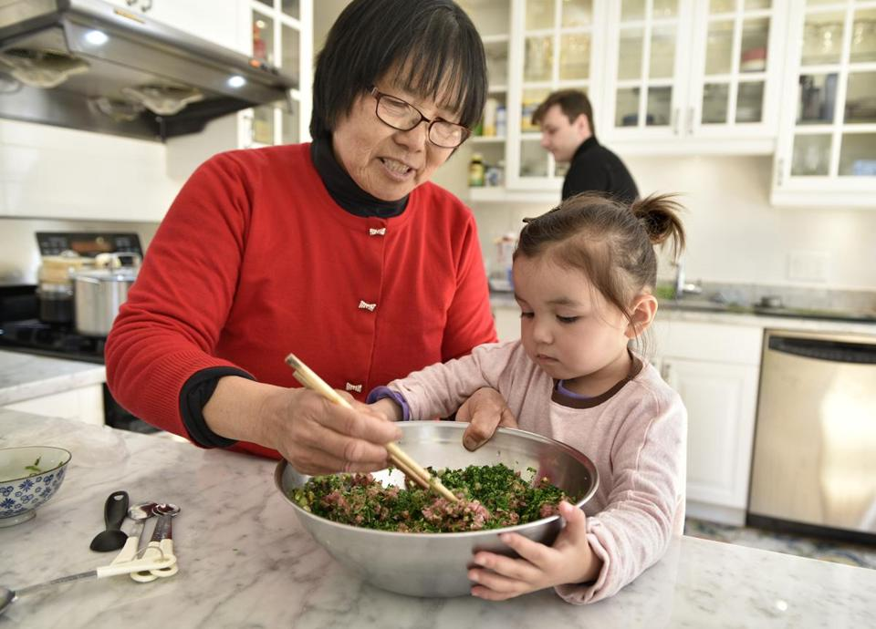 Ginger Chen (with granddaughter Stella Faulkner) puts foraged Shepherd's Purse into dumpling filling.
