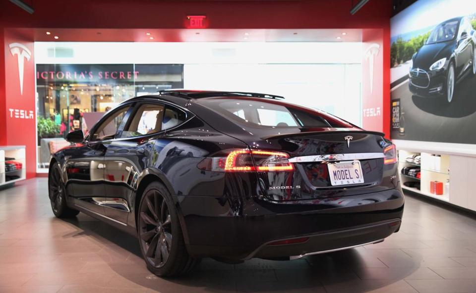 Natick, MA 111913 Tesla Model S car was on display at a store in the Natick Mall, Tuesday, November 19 2013. (Globe Staff/Wendy Maeda) section: Business slug: 20Tesla reporter: Callum Borchers