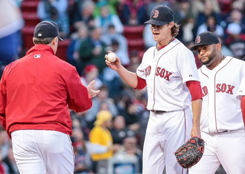Manager John Farrell gets the ball from Red Sox starter Clay Buchholz in the third inning.