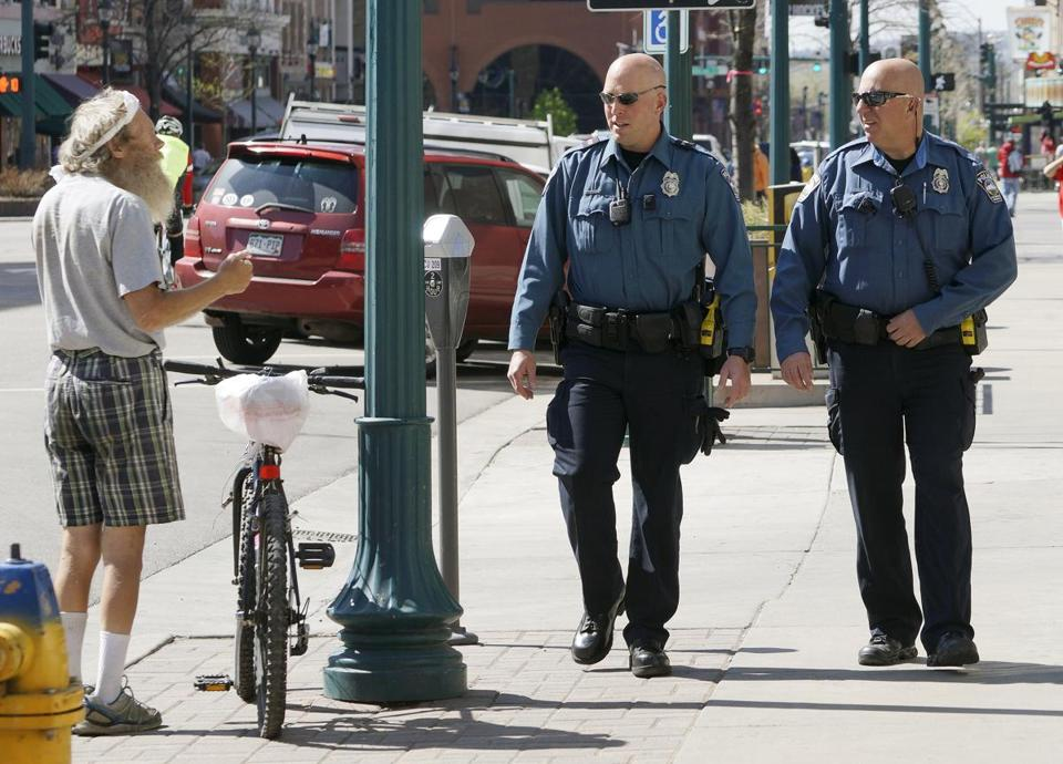Colorado Springs Police Officers Barry Rizk (left) and Jeremy Winn were on foot patrol with body cameras last week.