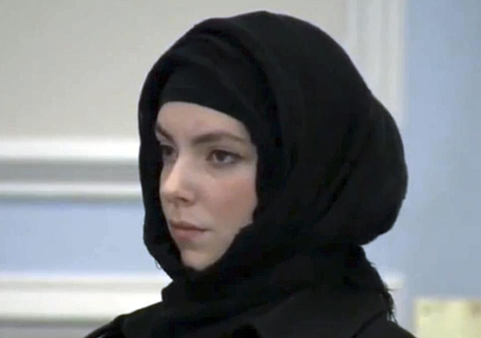 Katherine Russell, widow of Boston Marathon bombing suspect Tamerlan Tsarnaev, stands during a hearing in district court Thursday, Jan. 9, 2013, in Wrentham, Mass., on charges of driving with a suspended license, speeding and driving an unregistered motor vehicle in Franklin, Mass., in August. She was found responsible for speeding, but the other two charges were dismissed. (AP Photo/WCVB-TV thebostonchannel.com, Pool)