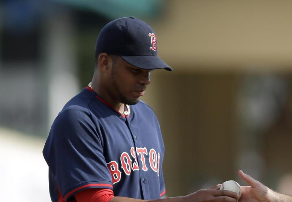 Boston Red Sox pitcher Dalier Hinojosa, left, is removed from an exhibition spring training baseball game by manager John Farrell during the sixth inning against the St. Louis Cardinals Wednesday, March 5, 2014, in Jupiter, Fla. (AP Photo/Jeff Roberson)