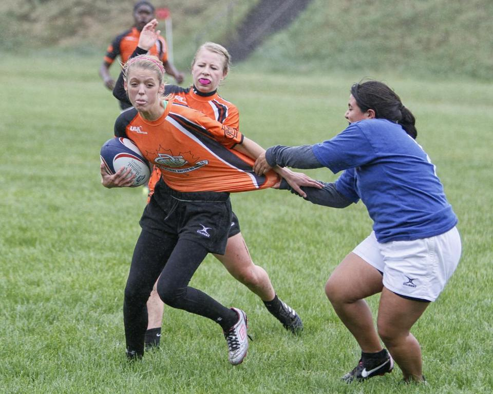 A player from a team representing Newton South High School (right) tried to drag down an opponent during the 2013 Massachusetts Youth Rugby Organization High School Championships. The Massachusetts Interscholastic Athletic Council will vote next month on whether the MIAA should recognize rugby as a sport.