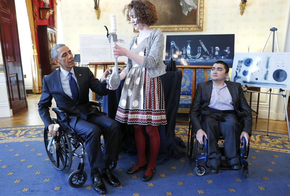 At the White House Science Fair, Dover teen Kaitlin Reed shows President Obama a wheel-chair lever she created with fellow NuVu Studio student Mohammad Sayed (right).