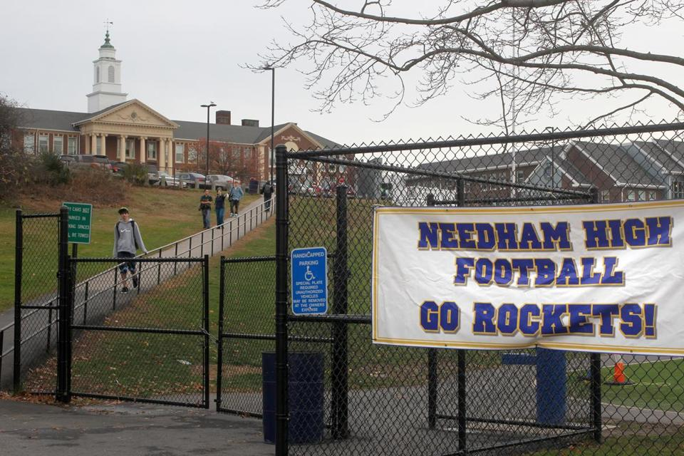 Racist graffiti was found in two boys' bathrooms at Needham High School during the past month, according to a letter sent Tuesday from the school's principal.