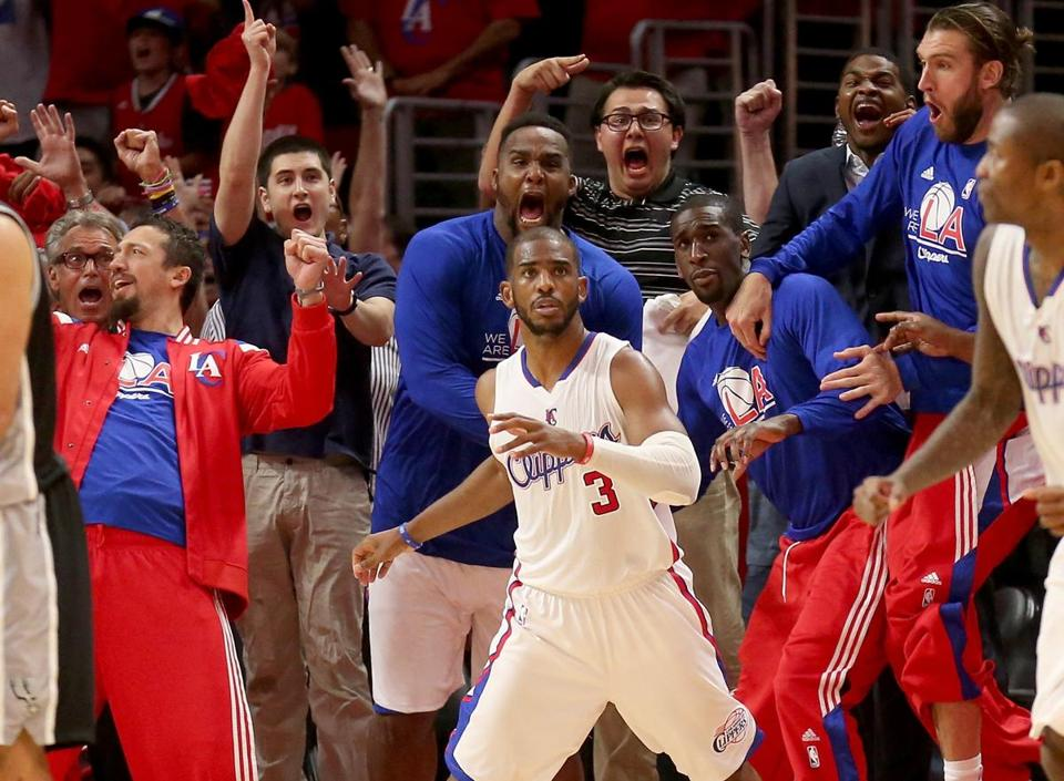 Chris Paul and the Clippers bench react after Paul's last-second basket.