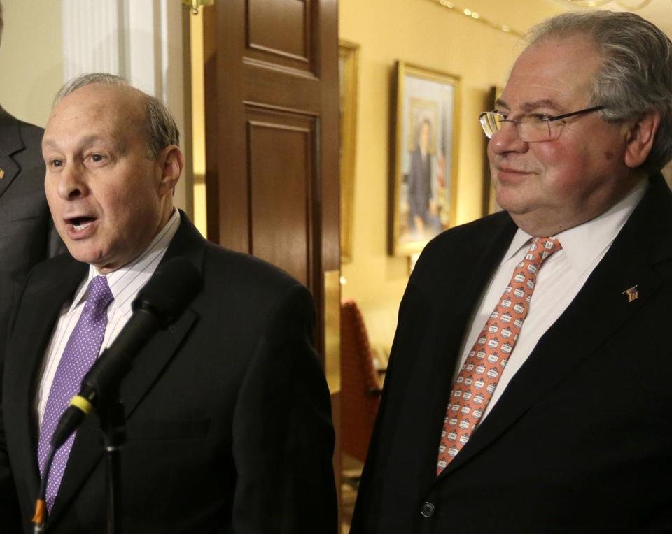 Massachusetts Democratic legislative leaders Senate President Stanley Rosenberg, left, and House Speaker Robert DeLeo, right, face reporters during a news conference Monday, Jan. 12, 2015, outside the governor's office at the Statehouse, in Boston. (AP Photo/Steven Senne)